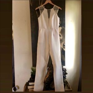 BCBGeneration jumpsuit with lace inset New w/ tags